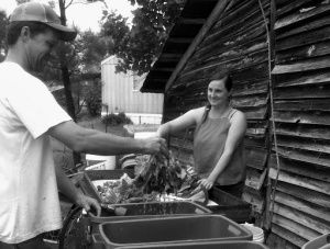 Ben and Patricia washing veggies. This was our first wash station.